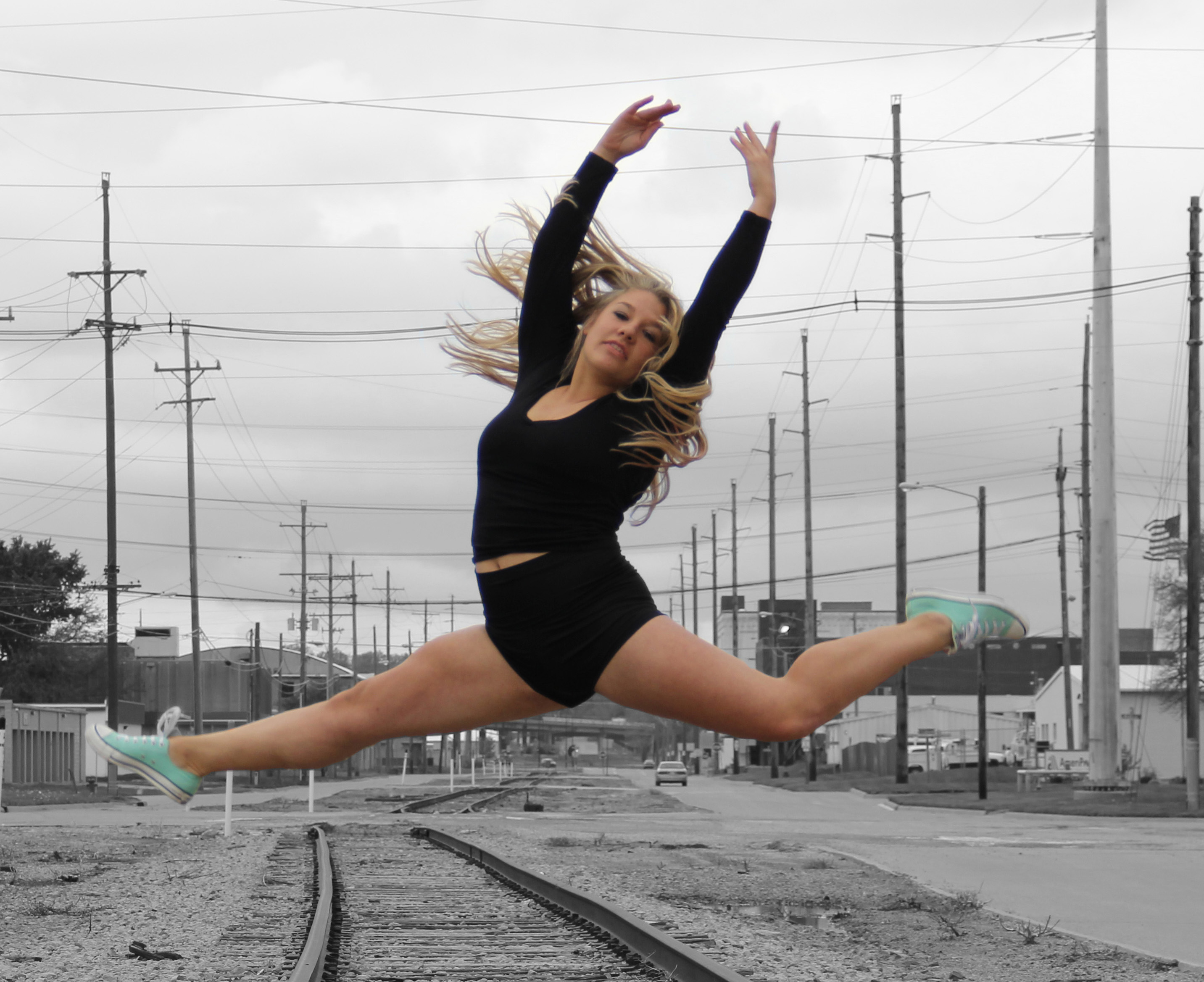 Dancer from the Dance Factory dance studio in Topeka, Kansas jumping over railroad tracks - GALLERIES